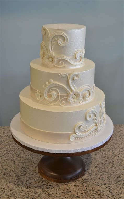 Buttercream wedding cake with whimsical swirls