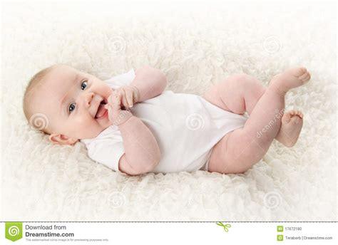 laying on back baby lying on back smiling stock photo image of hair 17672180