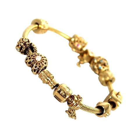 pandora gold 8 embellished charm bracelet