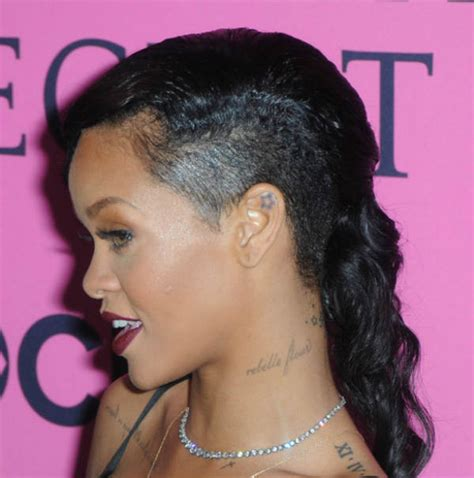 tattoo behind rihanna s ear in pics rihanna s all of the 20 tattoos catch news