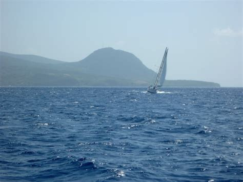 sailing boat heeling sailing in guadeloupe wind and sail