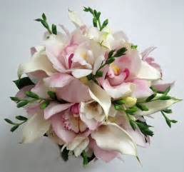 orchid bouquet cymbidium call and freesia bouquet dahlia floral design