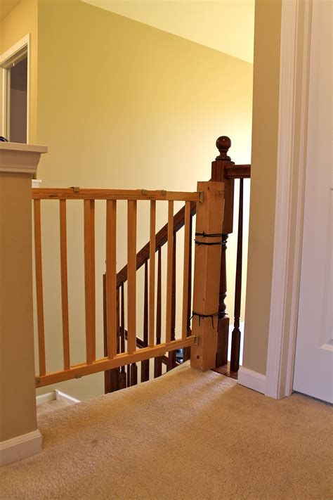 Gate For Stairs With Banister by How To Install A Stair Safety Gate Without Ruining Your