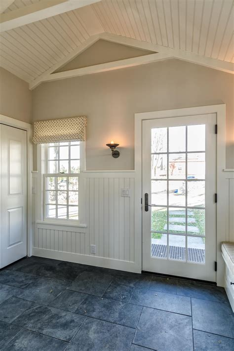 Cottage Wainscoting by Mudroom With Beadboard Wainscoting And Gray Slate Floor Hgtv
