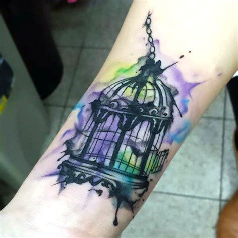 simple watercolor birdcage tattoo idea
