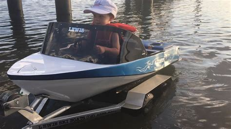 mini ski boat two year old drives his own mini petrol powered speed boat