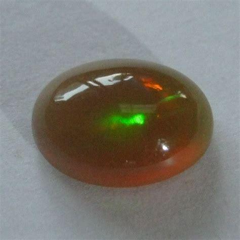 Kalimaya Teh Pekat batu mulia opal pekat pelangi 0 90 carat