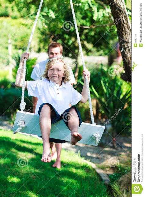 is swinging fun dad and kid having fun swinging together stock images