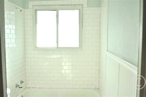 wall tile beading shower has subway tile in brick pattern with bead board