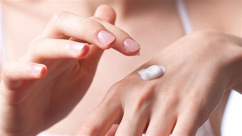 apply hand lotion dry hands
