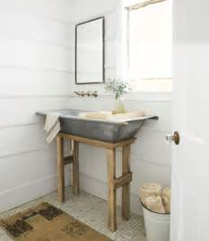 Style with a repurposed galvanized hay bin sink via country living