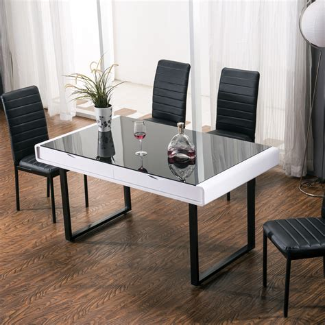 black glass top dining table maestro dining table white high gloss w black glass top