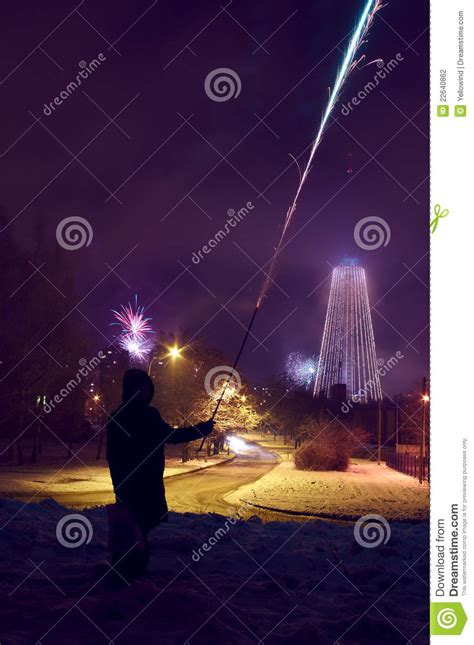 new years shooting person is shooting fireworks at new years stock