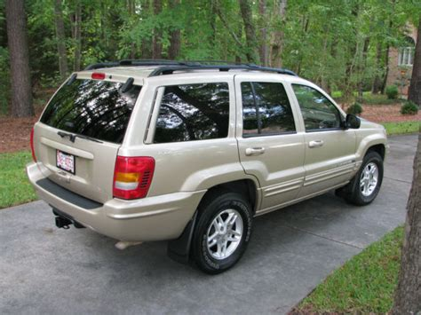 2000 gold jeep grand 1j4gw58n8yc370059 2000 gold jeep grand limited