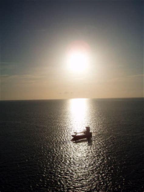 small boat in the ocean small boat in large ocean by orangehaze48 on deviantart