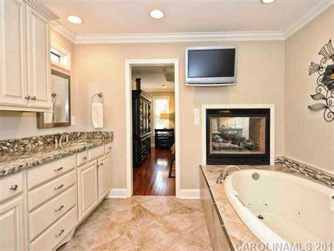 double sided fireplace  master bedroom bathroom