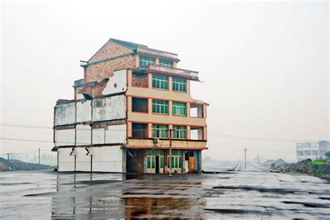 new china house nail house chinese home that stood in center of new highway is demolished inhabitat green