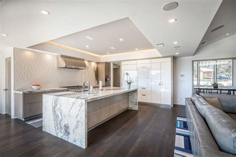 Modern Tray Ceiling Waterfall Countertop For A Contemporary Kitchen With A