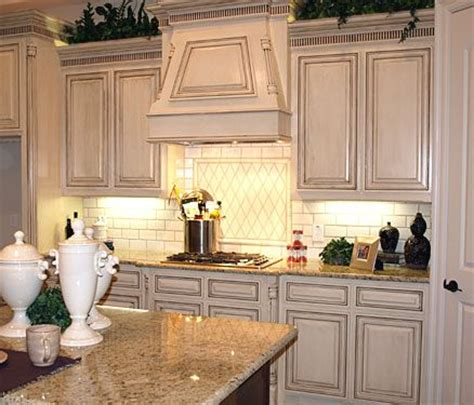 Antique White Glazed Kitchen Cabinets Glazed White Kitchen Cabinets In Combination With Countertops And Backsplashes Of Light