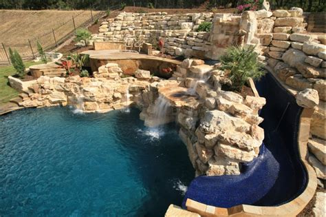 exceptional Small Backyard Patio Ideas #4: Large-Hill-Country-Waterfall-with-Slide-and-Small-Grotto-Rock.jpg