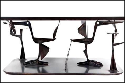 sculptural steel and brass birds coffee table by paul