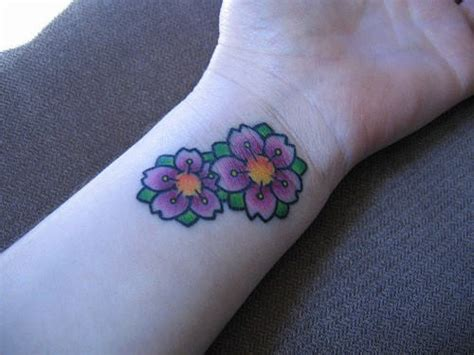 cherry blossom tattoo on wrist cherry blossom tattoos