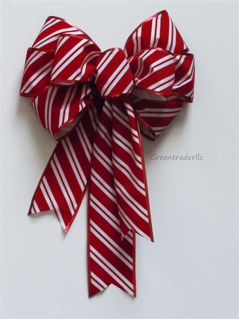 outdoor candycane ribbon bow in outdoor wreath by simplyadornmentsss