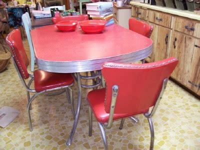 a 50 s retro kitchen table and chairs and cleaning chrome