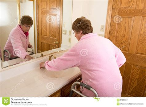 ladies using the bathroom elderly senior woman washing up stock photo image 64289612