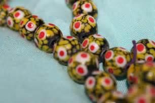 arti tato bulu merak my notes kanvas aksara borneo beads manik manik suku
