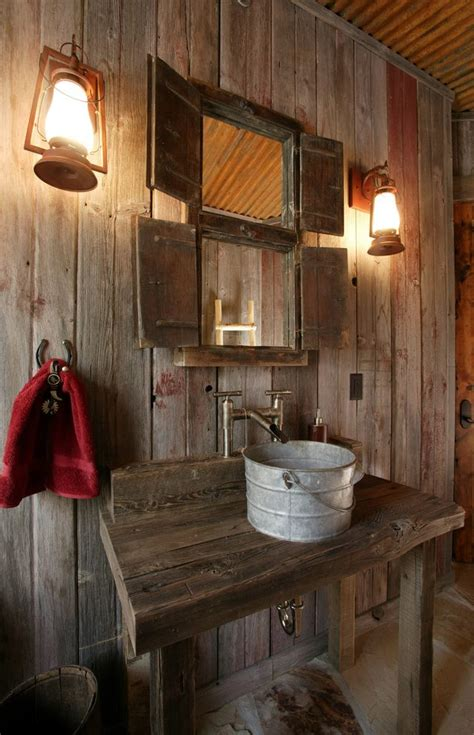 Cabin Bathroom Ideas rustic interior powder room with horseshoe copper vessel sinks