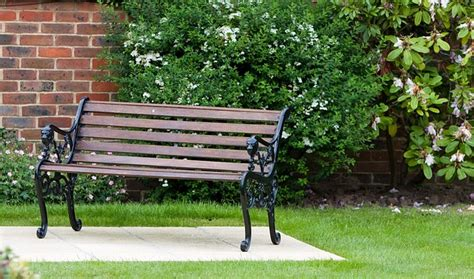 garden bench wrought iron and wood garden bench seat wood wooden wrought iron iron public domain pictures free