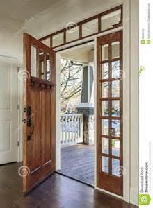 open door homes interior of an open wooden front door stock photo