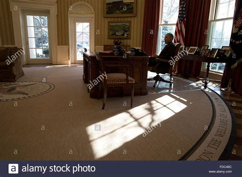 what floor is the oval office on u s president barack obama sits at the resolute desk as