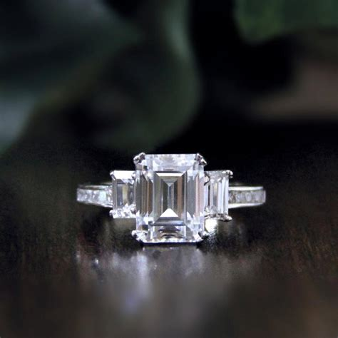 3 36 ct tw emerald cut simulant engagement ring