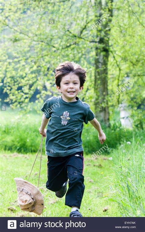 what to get a 7 year old boy for christmas 5 to 7 year caucasian boy outdoor running towards viewer in stock photo royalty free