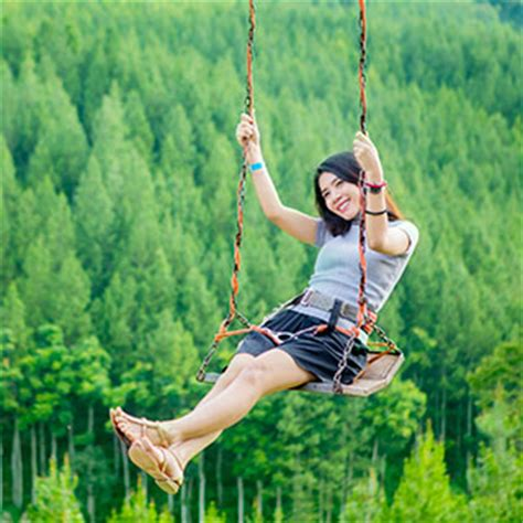 swinging in asia asian woman playing on swing asian stock photos