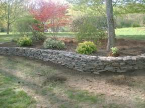 natural rock retaining wall and flower beds salem nh labrie property maintenance and