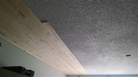 Wood Plank Ceiling Cost It Was Boring Popcorn Ceiling Until He Screwed In These