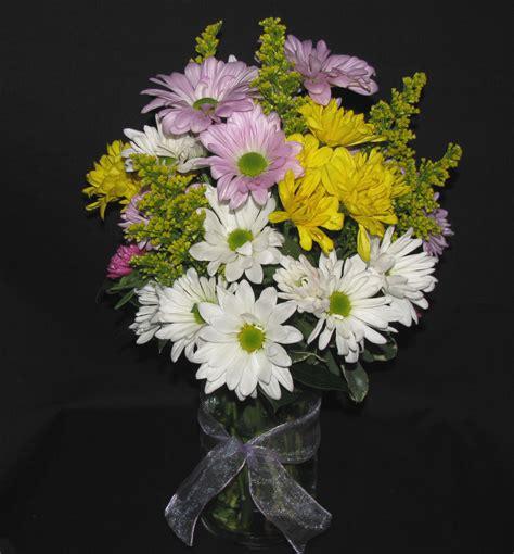 Daisies In A Vase by Vase