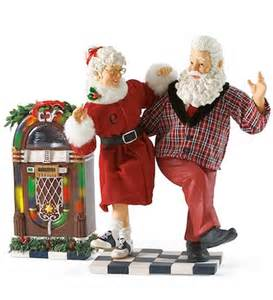 jingle bell rock santa claus figurines and hand carved