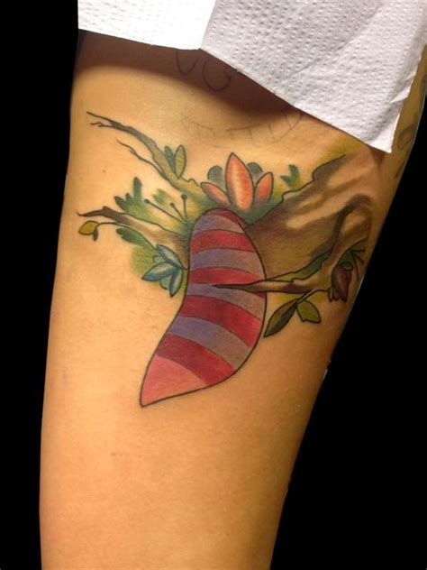 cat tattoo tail cheshire cat tail in the trees by daniel adamczyk tattoonow
