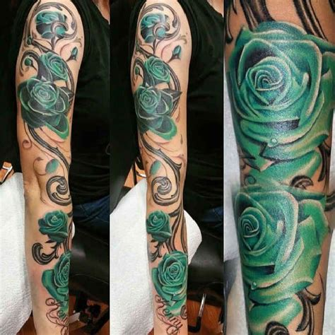 green rose tattoo green blossom vine tattooed