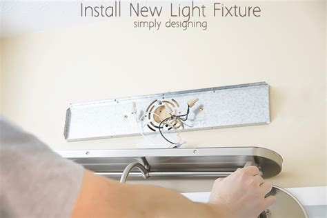 installing a bathroom light fixture install a new bathroom light fixture