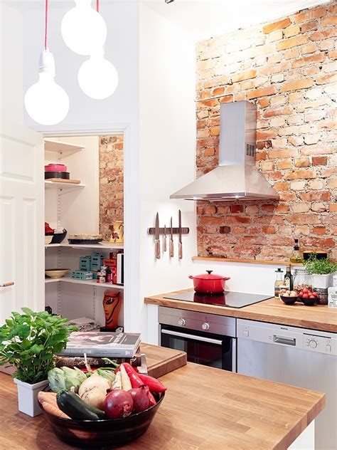 brick wall in kitchen incorporating exposed bricks in stylish designs around the