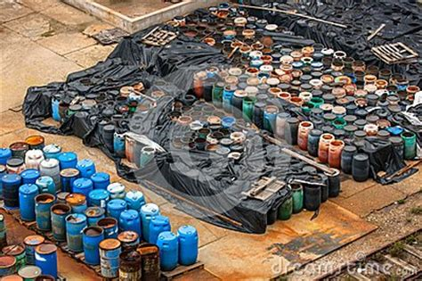 Dump Chemistry Designed By Bonaque by Chemical Waste Dump With A Lot Of Barrels Stock