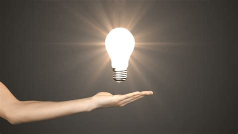 Hand Holding A Light Bulb In The Dark The L Lights Up Light Up Pictures