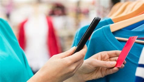 Smart Phone Smart Shopping by Smart Shoppers Use Their Smartphone To Research Instore