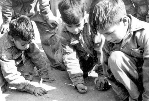 imagenes niños jugando a las canicas la guerra origen del d 237 a del ni 241 o grupo milenio