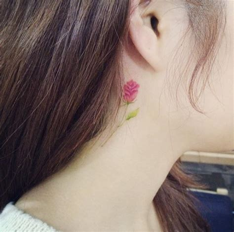 flower tattoo behind ear meaning 30 colorful daring sneaky peek a boo ear tattoos